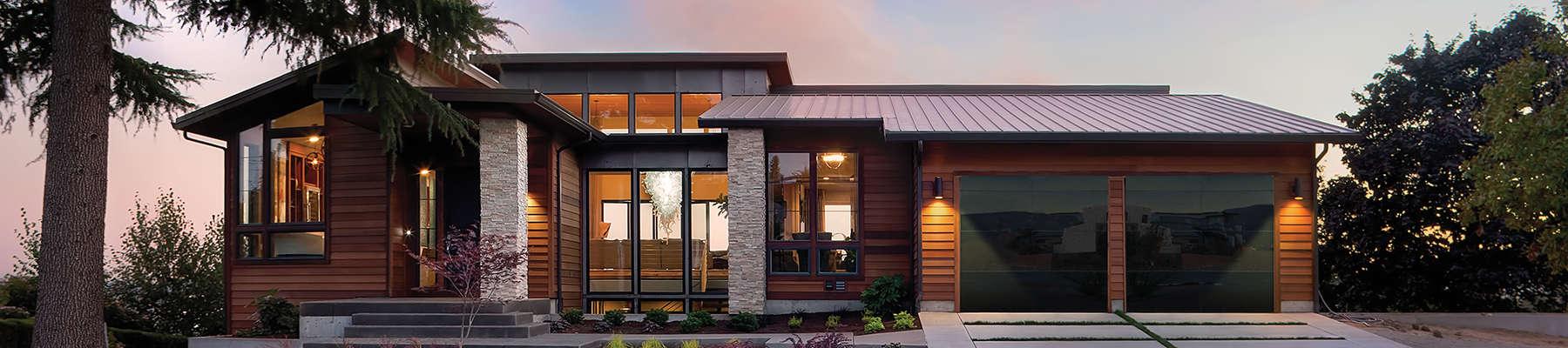 beautiful home featuring double garage doors